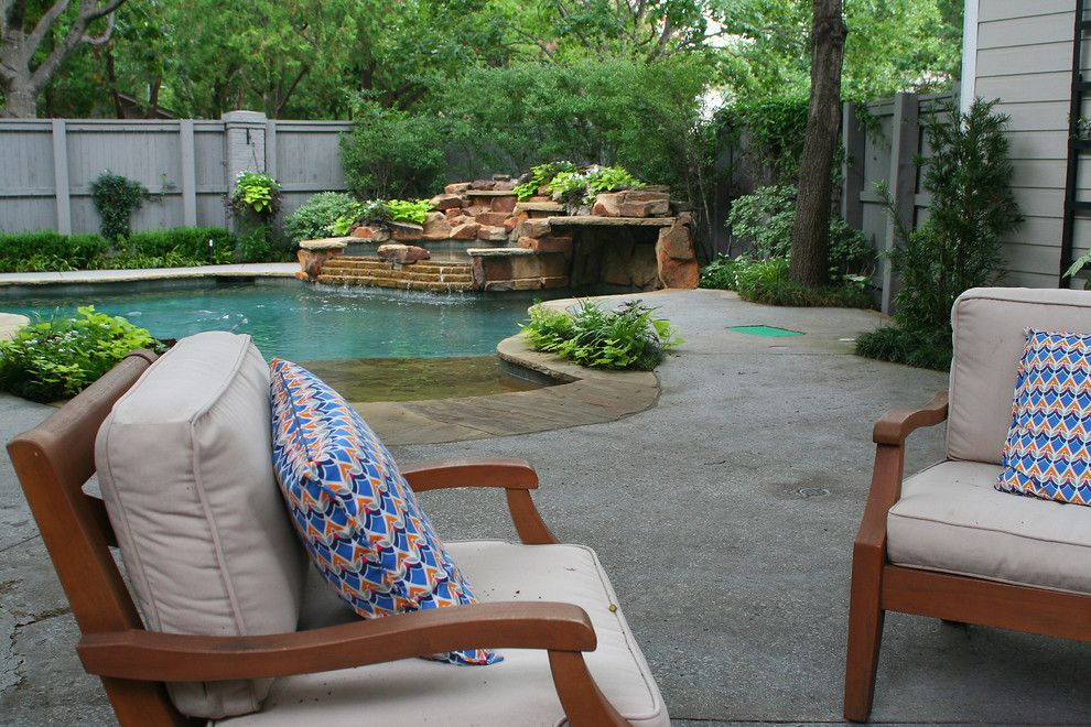 Lowes Dallas for a Transitional Landscape with a Landscape and Lush Backyard Landscape with Pool by Verdant Grounds