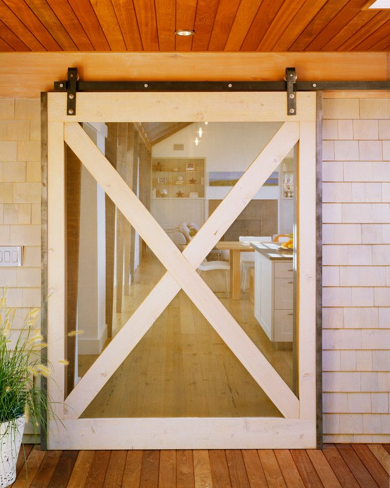 Lowes Door Installation for a Beach Style Entry with a Batten Screen Door and Cedar Point by Hutker Architects