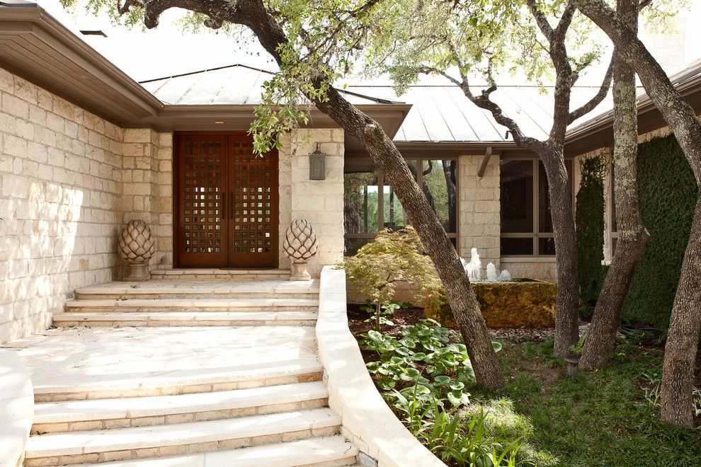 Lowes Door Installation for a Contemporary Exterior with a Checkered Glass Front Door and Cord Shiflet Lake Austin Estate by Cord Shiflet
