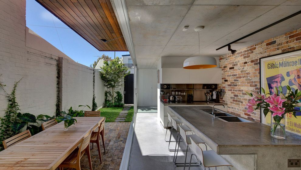 Lowes Queensbury Ny for a Contemporary Kitchen with a Large Pendant Light and Long Courtyard House by Scale Architecture