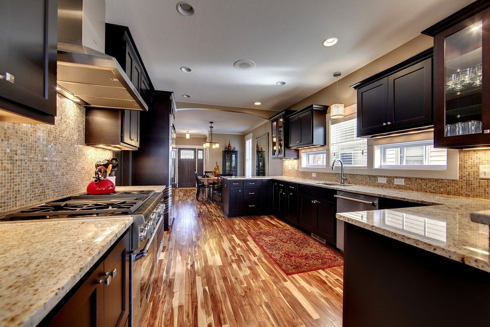 Lumber Liquidators Reviews for a Traditional Kitchen with a Unique Backsplash and Kitchen by Sustainable Nine Design + Build
