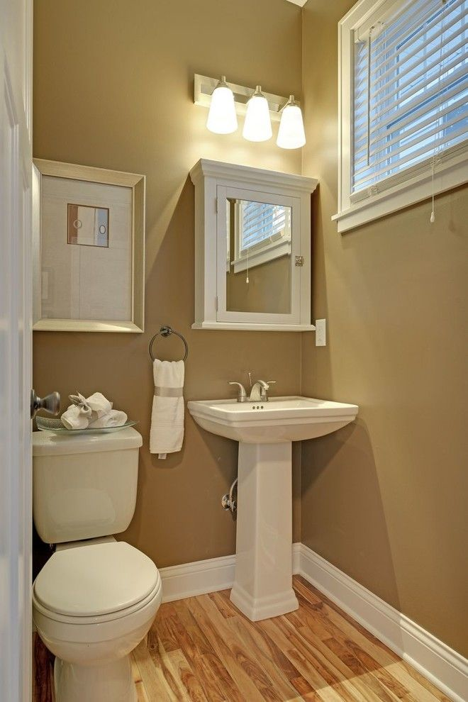 Lumber Liquidators Reviews for a Traditional Powder Room with a Traditional and Guest Bathroom by Sustainable Nine Design + Build