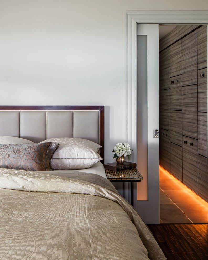Lumiere Lighting for a Contemporary Bedroom with a Frosted Glass Door and Modern Rustic by Applegate Tran Interiors