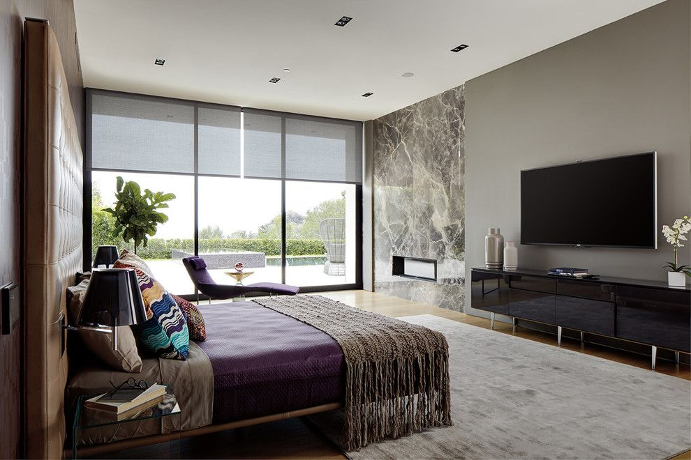 Lutron Homeworks for a Contemporary Bedroom with a Wall Mounted Tv and Bedrooms by Magnolia Design Center