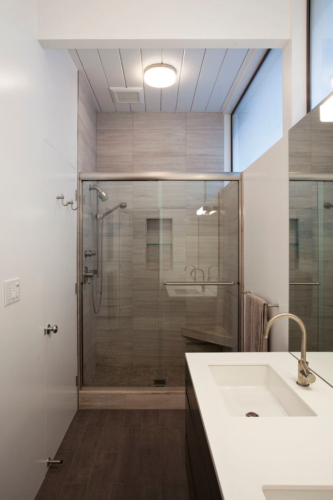 Luxe Hotel Sunset for a Midcentury Bathroom with a Dark Floor and Eichler Front Addition by Klopf Architecture