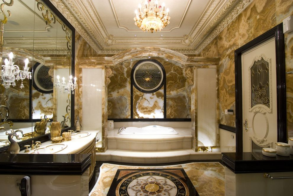 Luxe Hotel Sunset for a Traditional Bathroom with a Wainscoting and Our Mom's House by Erwin Hawawinata / Hawawinata N Associates