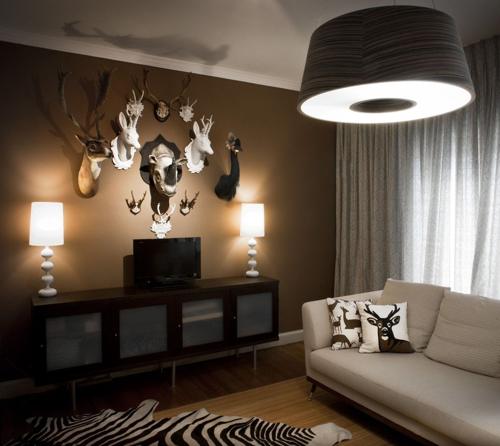 Mancaves for a Contemporary Family Room with a Brown Walls and Supon Phornirunlit/ Naked Decor by Supon Phornirunlit / Naked Decor