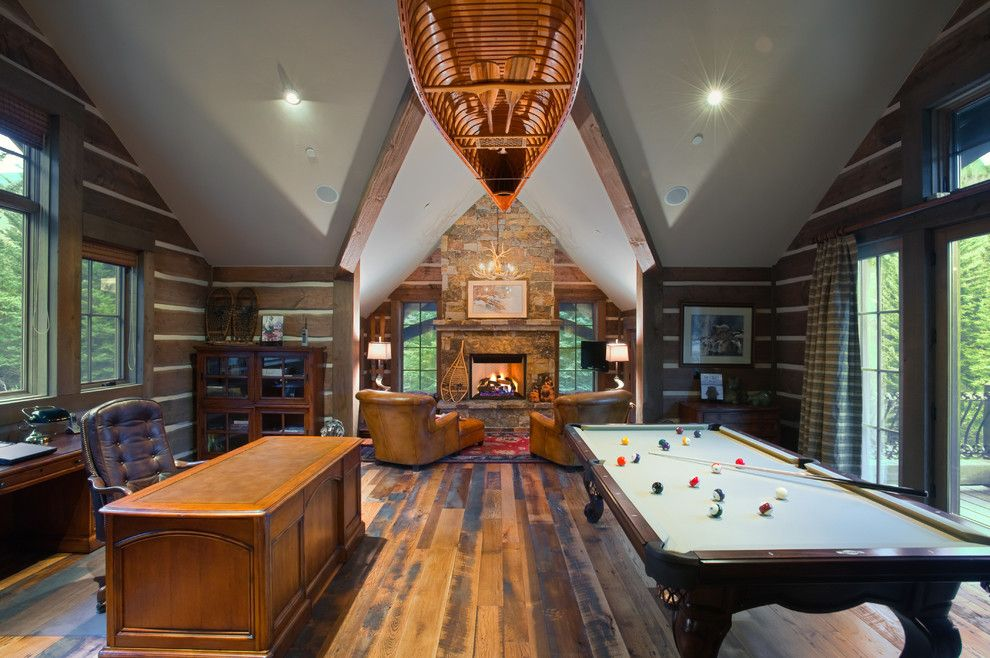 Mancaves for a Rustic Family Room with a Dry Stack and Vail Valley Retreat by Ulf & Associates