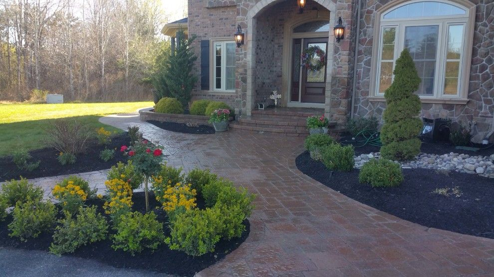 Marbeck Appliance for a Craftsman Patio with a Firepit and Front Walkway by Hansens Landscaping