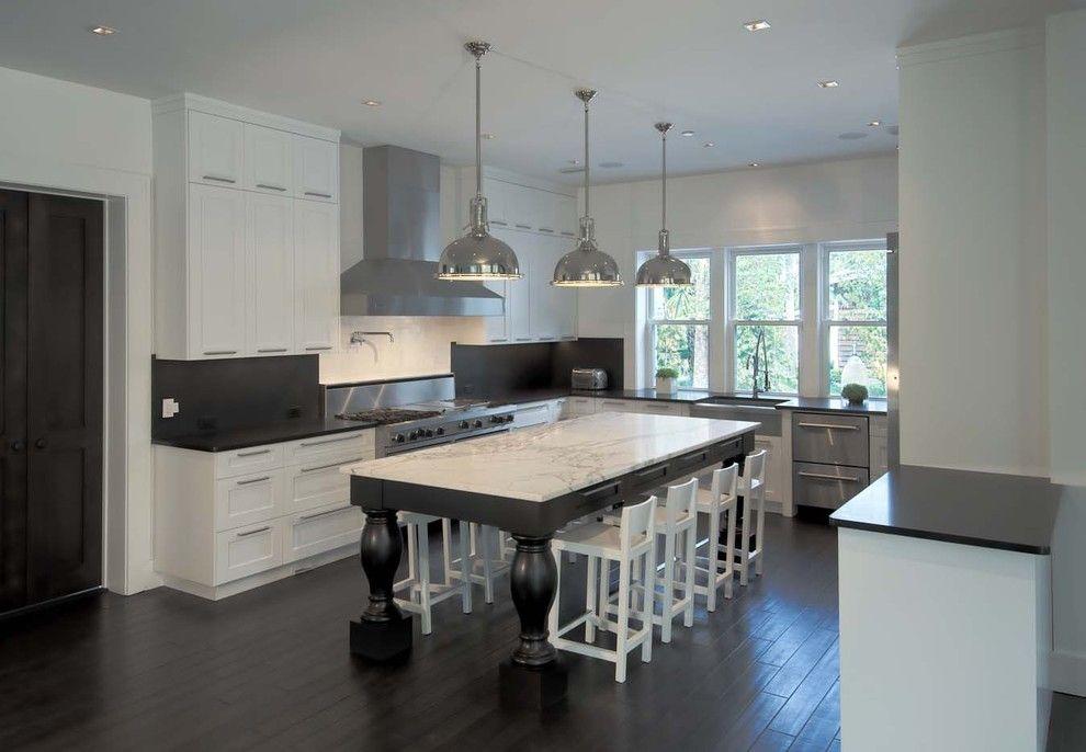 Marble Slab Locations for a Contemporary Kitchen with a Pot Filler and Contemporary Kitchen by kmhdesigninc.com