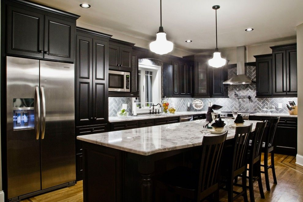 Marble Slab Locations for a Traditional Kitchen with a Black Kitchen Cabinets and Traditional Kitchen Designs by Kitchen and Bath World, Inc