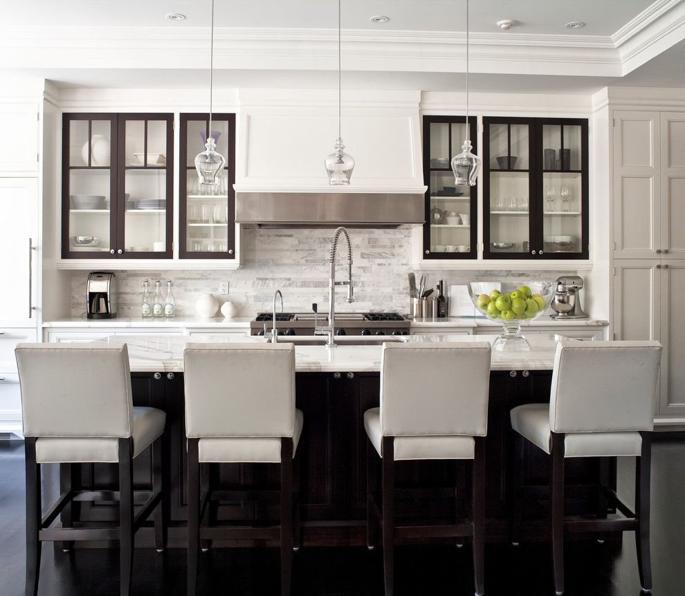 Marble Slab Locations for a Transitional Kitchen with a Dark Wood Floor and City Homes by Jennifer Worts Design Inc.