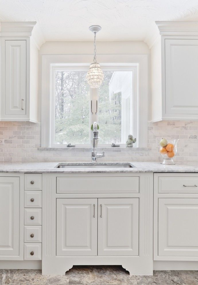 Marble Slab Near Me for a Traditional Kitchen with a Marble Countertop and White Kitchen by Cathy Stathopoulos, Ckd