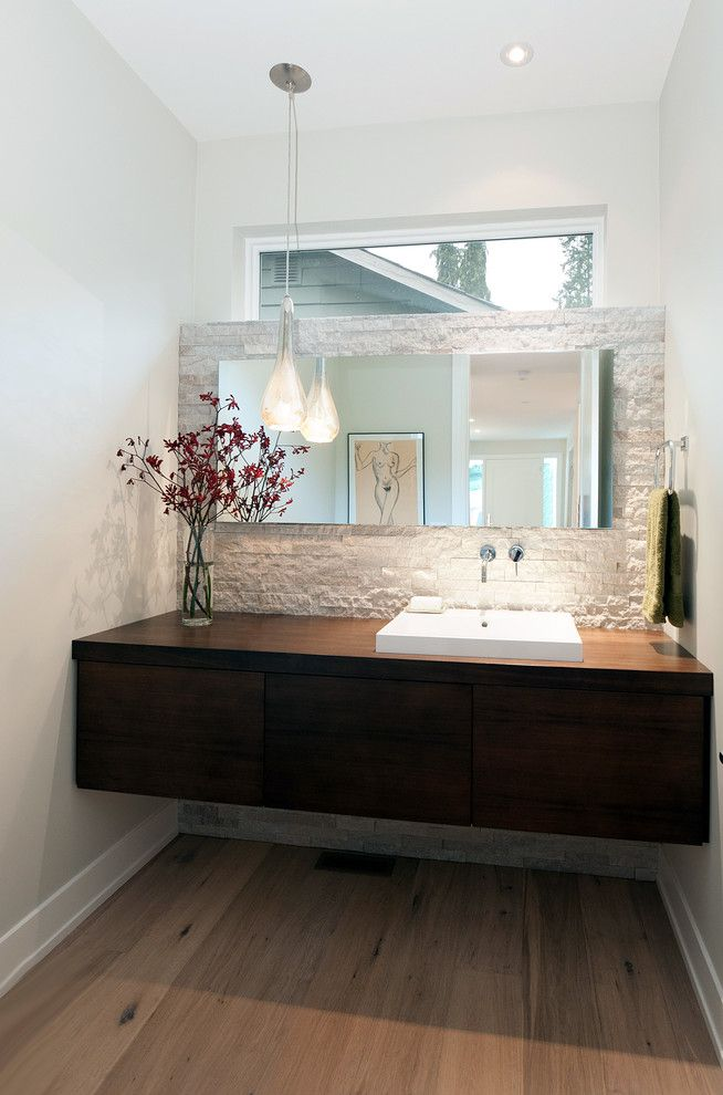 Marquis at Stone Oak for a Contemporary Powder Room with a White Stone Wall and Lloyd Avenue Residence by Erica Winterfield Design