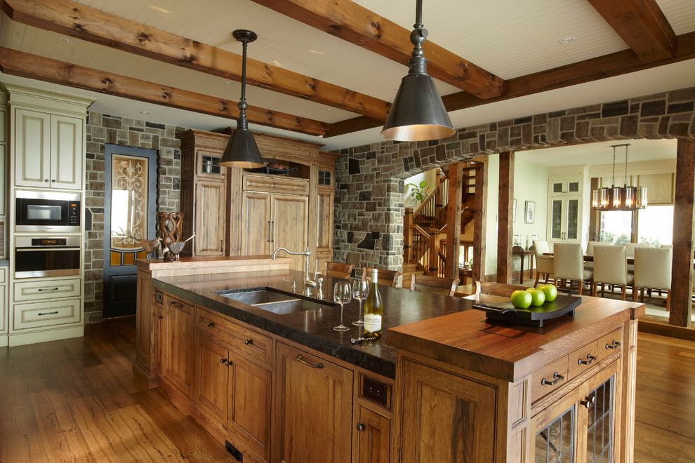 Marquis at Stone Oak for a Rustic Kitchen with a Panel Refrigerator and the Cottage by Parkyn Design