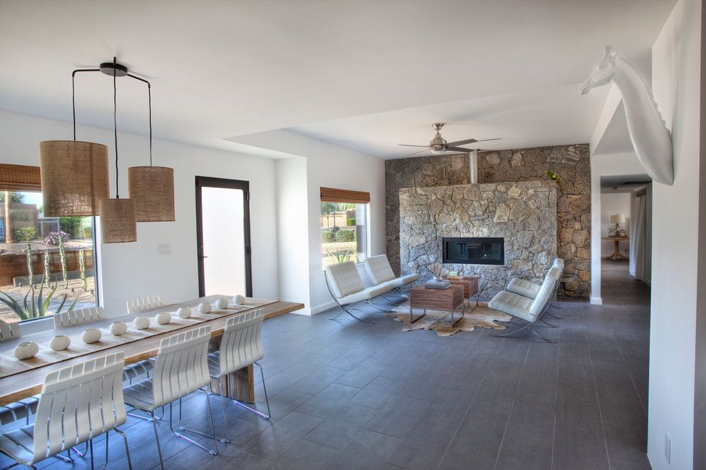 Masonry Veneer for a Southwestern Living Room with a Porcelain Floor and Black House (Steinman Renovation) by Spry Architecture