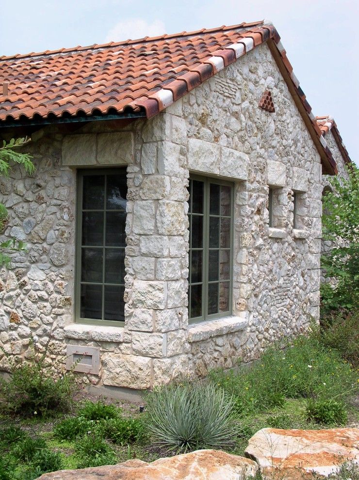Masons Supply for a Mediterranean Exterior with a Mediterranean and Stone Veneer Detailing by Rick O'donnell Architect