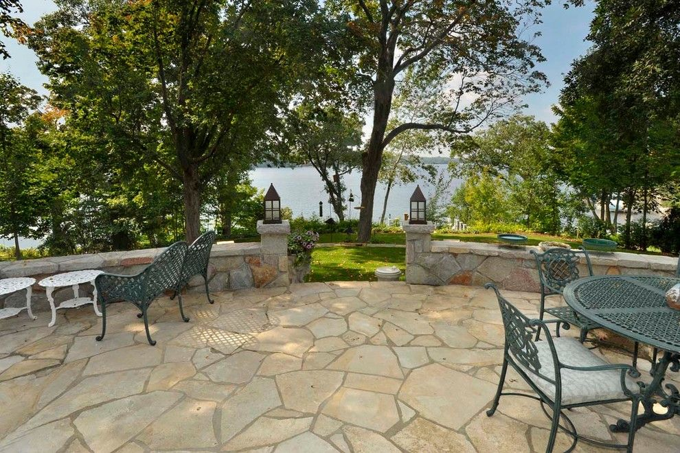 Masons Supply for a Traditional Landscape with a Stone Wall and 28. Lake Minnetonka Cottage by Sharratt Design & Company