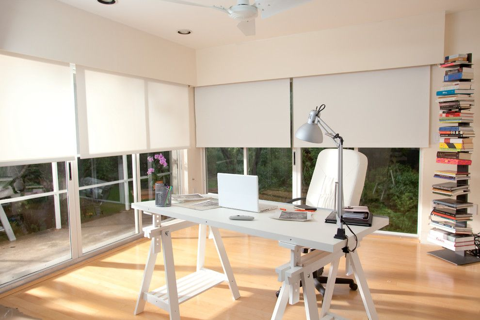 Mastic Home Exteriors for a Modern Home Office with a Ceiling Fan and Somfy by Somfy Systems
