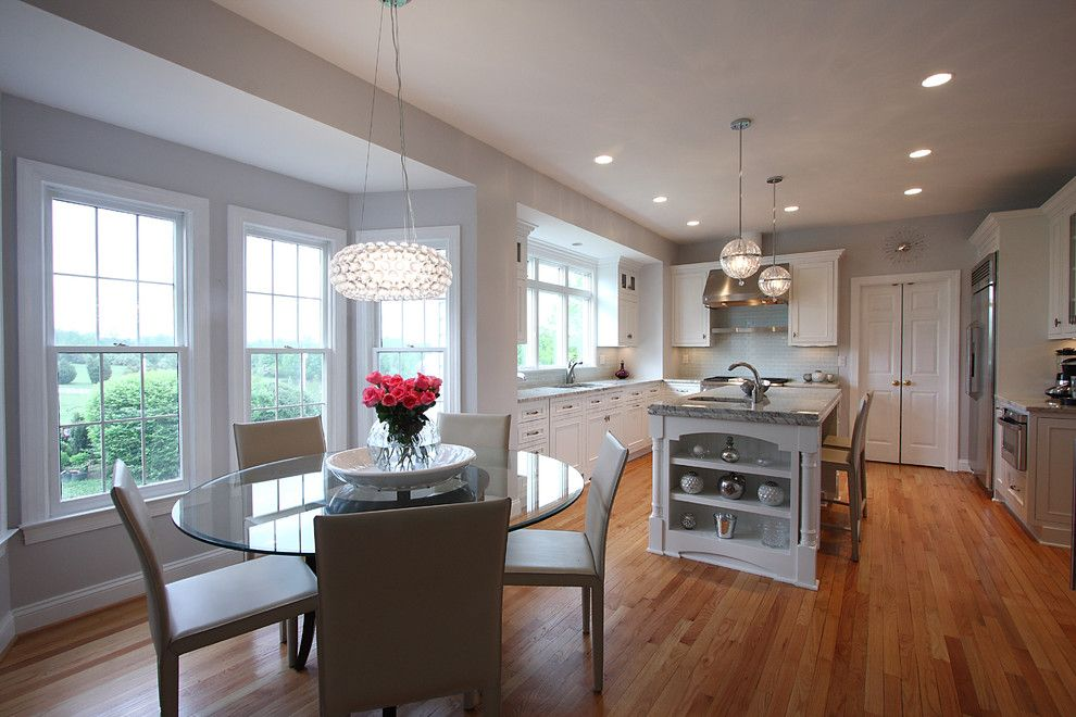 Mayer Electric Supply for a Traditional Kitchen with a Wood Floor and Contemporary Lighting + Classic Design by Nvs Remodeling & Design