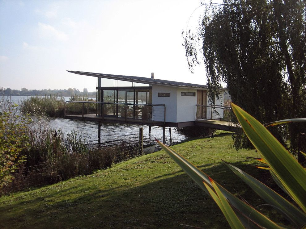 Mcloone's Pier House for a Midcentury Exterior with a Glass Doors and the Boat House by Ar Design Studio Ltd