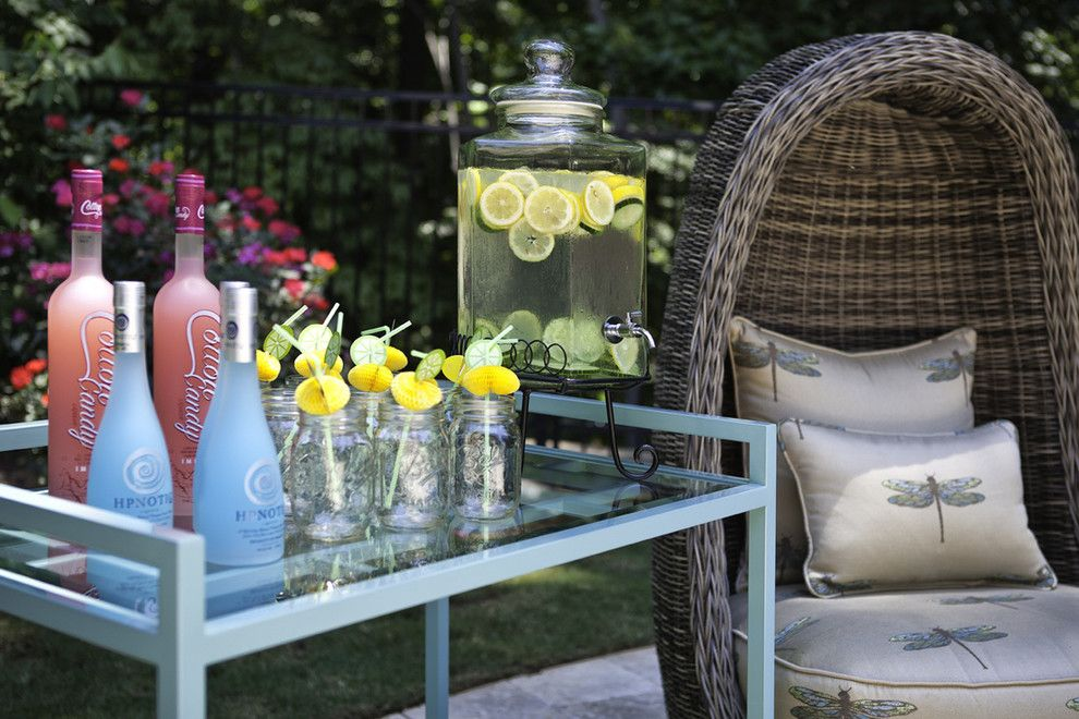 Mecca Furniture for a Beach Style Exterior with a Wicker Furniture and Outdoor Spaces by Kandrac & Kole Interior Designs, Inc.
