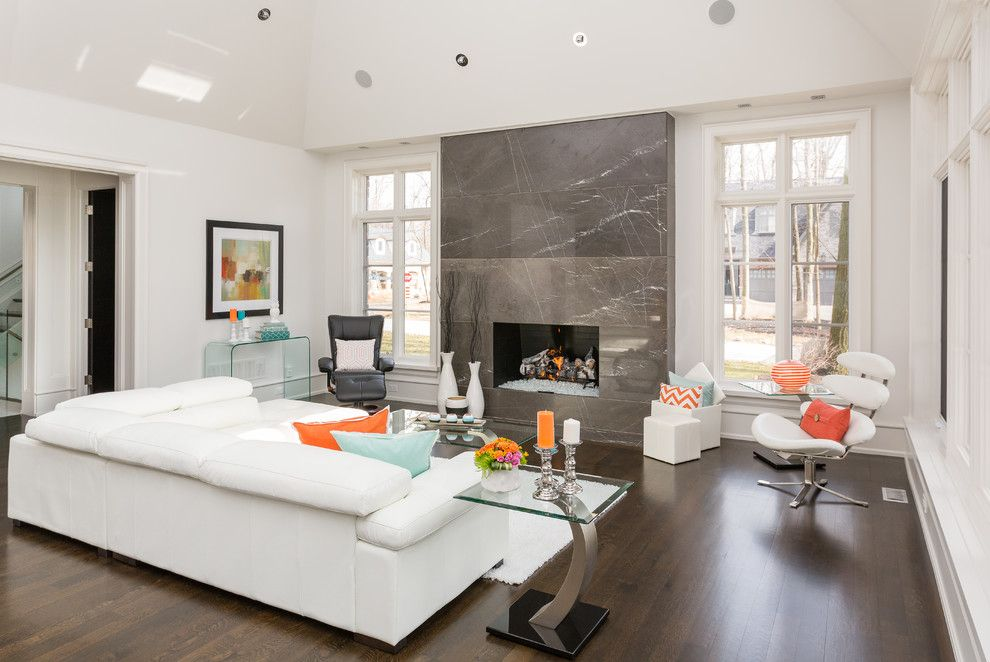 Mecca Furniture for a Contemporary Living Room with a White Sectional and Copper Corner by David Small Designs