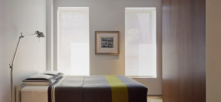 Mechoshade for a Modern Bedroom with a White Oak Hardwood Floor and Greenwich Street Loft by ZERAFA STUDIO LLC