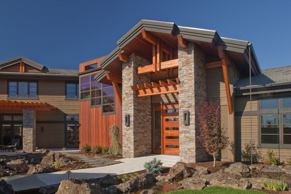Medallion Homes for a Craftsman Exterior with a Stone Exterior and Highland's Home in Bend, or by Norman Building & Design