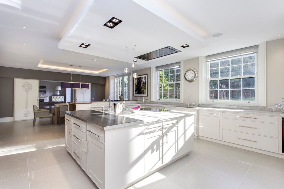 Meteor Lighting for a Transitional Kitchen with a Clock and Kylemore House by Hoban Design