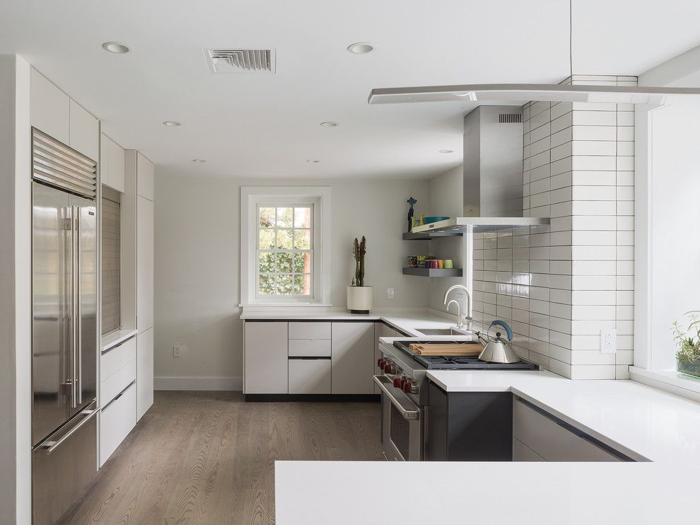 Michaels Flooring for a Contemporary Kitchen with a Range and Chestnut Hill Kitchen by C2 Architecture