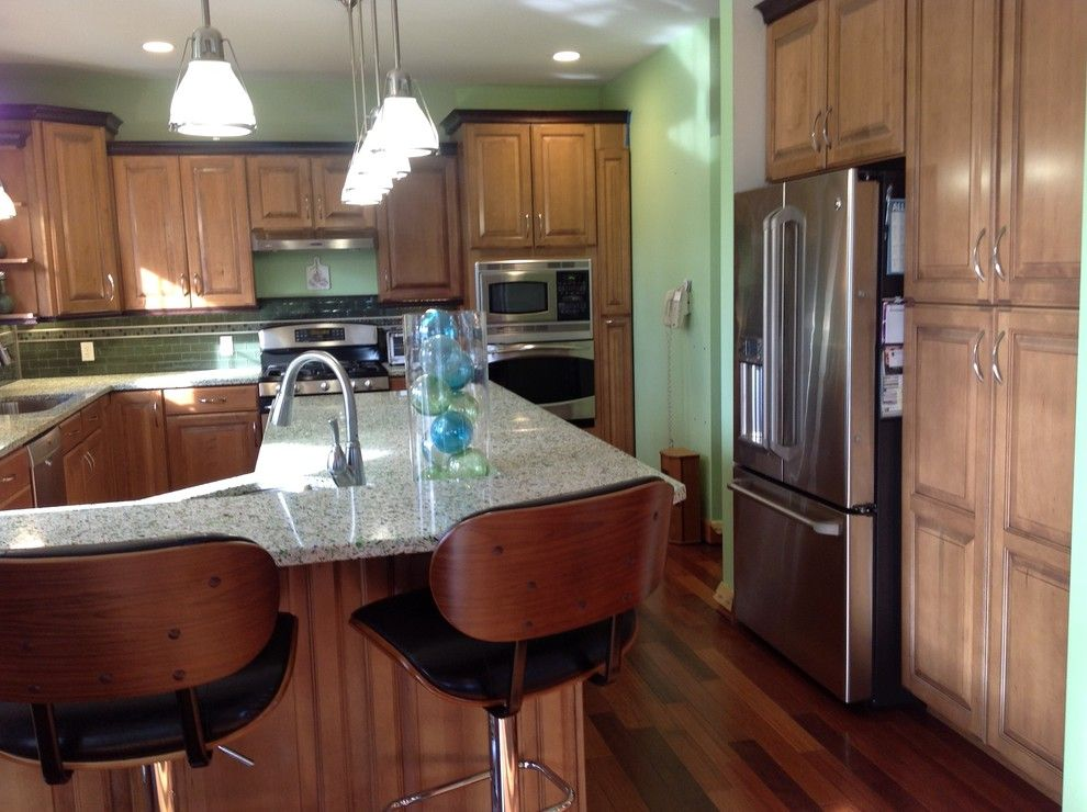 Michaels Flooring for a Eclectic Kitchen with a Wine Refrigerator and Vetrazzo Island by Avalon Kitchen