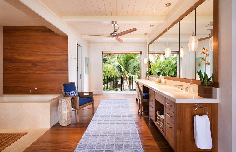 Mihomes for a Tropical Bathroom with a Wood Paneling and Maui Residence by April Powers Interior Design