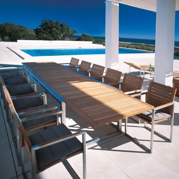 Mikes Furniture Chicago for a Modern Patio with a Modern Outdoor Dining and Teak Outdoor Extension Dining Table by Home Infatuation