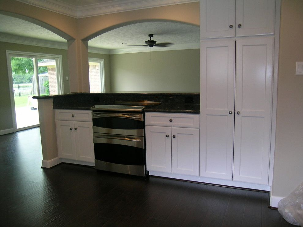 Mill Valley Golf Course for a Contemporary Kitchen with a Black Counters and Quail Valley Golf Course Home by Pride Custom Builders