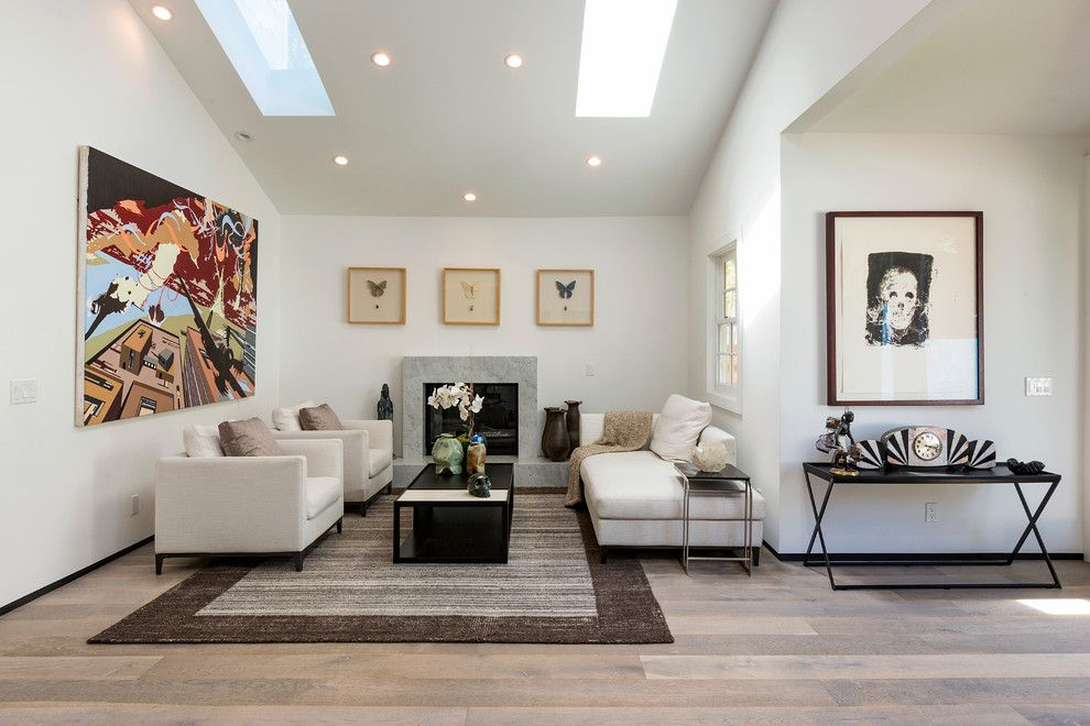 Minotti for a Contemporary Living Room with a Skylights and Beachwood Drive Residence by Xanadu Group