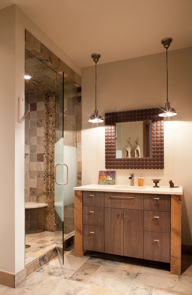 Moen Faucet Warranty for a Rustic Bathroom with a Pendant Light and Buckhorn Residence by Sunlit Architecture