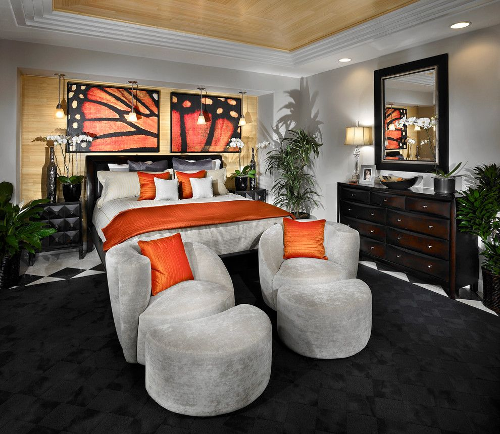 Monarch Butterfly Symbolism for a Contemporary Bedroom with a Tray Ceiling and Heritage at Vista Del Verde by Possibilities for Design, Inc.