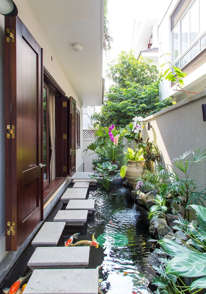 Monet's Garden for a Asian Landscape with a Folding Doors and Residence House in an Phu an Khanh ,District 2,Hcmc,Vietnam by Vietphu Design Construction Corporation