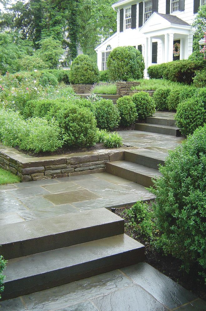 Monolithic Slab for a Traditional Landscape with a Bluestone Walkway and Bluestone Entry Walkway by the Todd Group