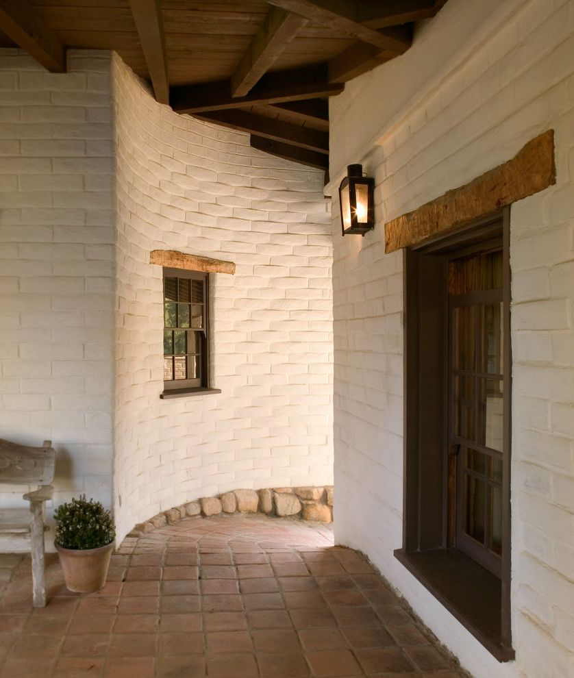 Montecito California for a Southwestern Exterior with a Wood Lintels and Exterior Hallway by Tom Meaney Architect, Aia
