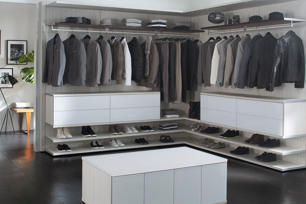 Morningstar Storage for a Contemporary Bedroom with a Dark Wood Flooring and Milano Grey Reach  in Closet by California Closets Hq