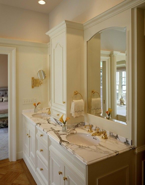 Morningstar Storage for a Traditional Bathroom with a Custom Marble Vanity and Calacatta Marble Vanity by Morningstar Stone & Tile