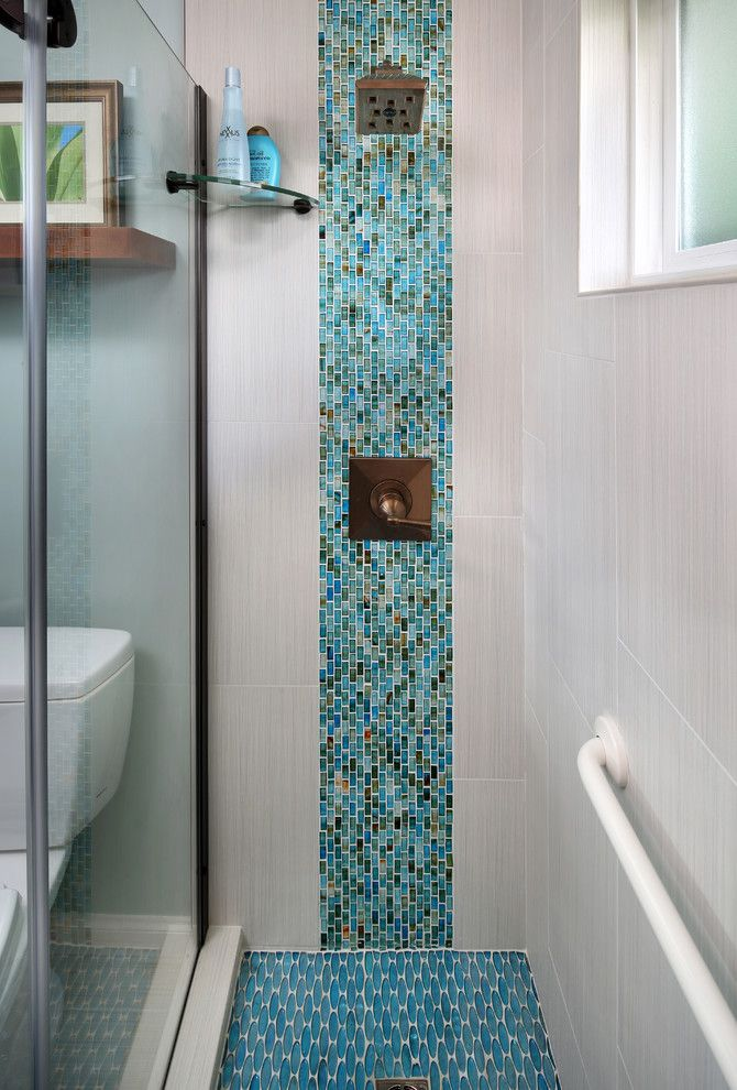 Mosaiq for a Tropical Bathroom with a Shower Shelf and Tropical Condo Bath by Gloria Carlson   Harrell Remodeling, Inc.