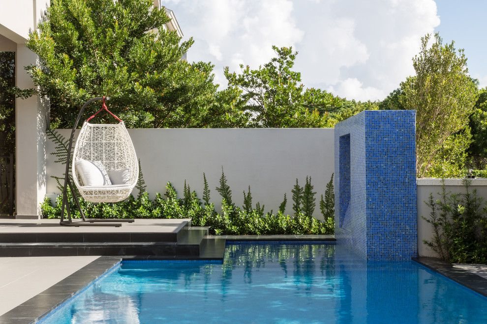Mosart for a Contemporary Pool with a Egg Swing and South Miami Townhouse by Touzet Studio