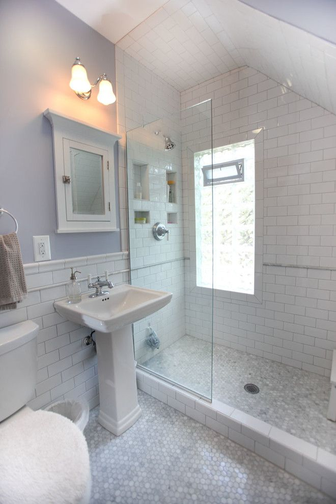 Mosart for a Traditional Bathroom with a White Subway Tile Shower and Minneapolis Victorian Bathroom Remodel by Castle Building & Remodeling