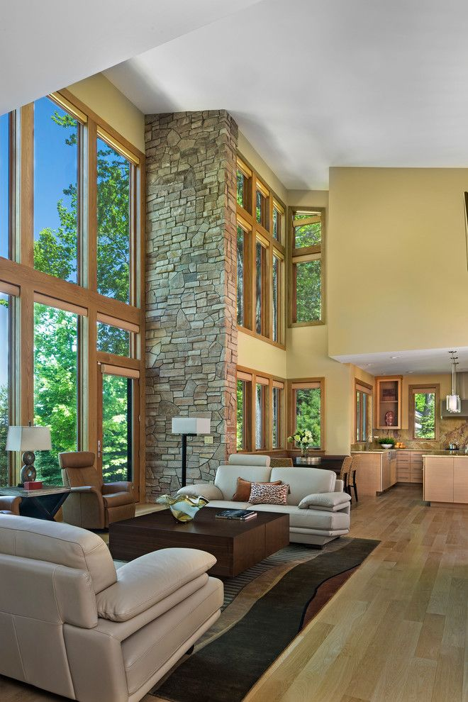 Mosey for a Transitional Living Room with a Two Story Window Wall and Modern Prairie Lake Home by Joseph Mosey Architecture, Inc.