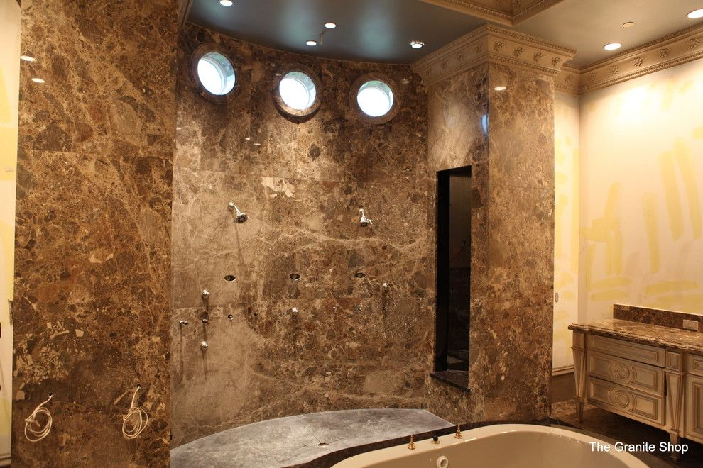 Munire for a Modern Bathroom with a Modern and Modern Slab Bathroom Floor with Design & Slab Shower by the Granite Shop
