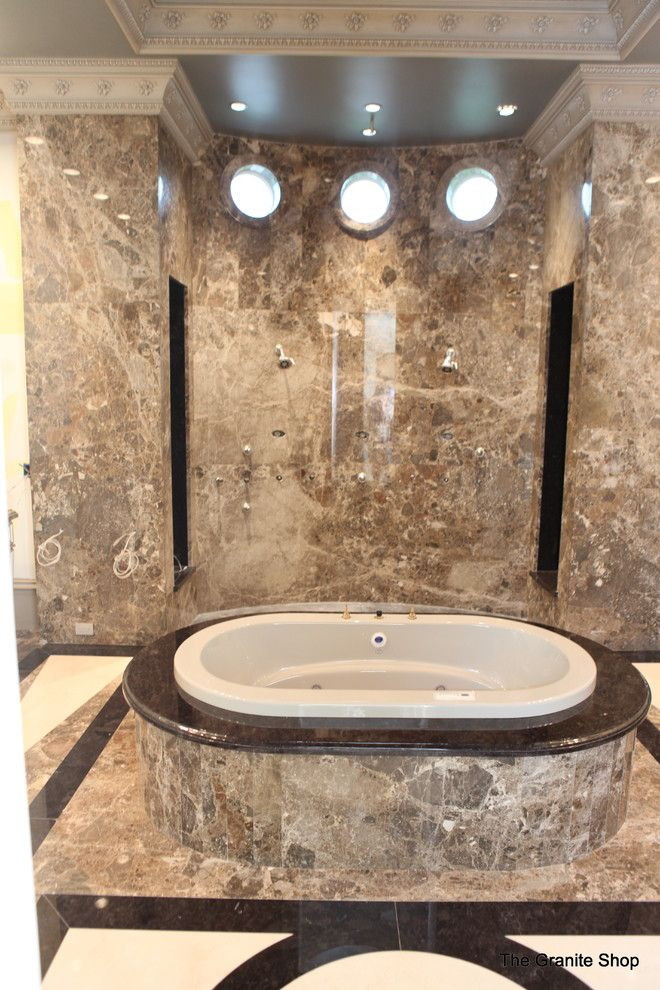 Munire for a Modern Bathroom with a Natural Stone and Modern Slab Bathroom Floor with Design & Slab Shower by the Granite Shop