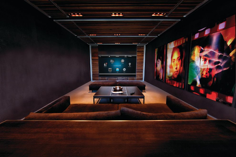 Murfreesboro Movie Theater for a Contemporary Home Theater with a Black Walls and Control4 by Control4